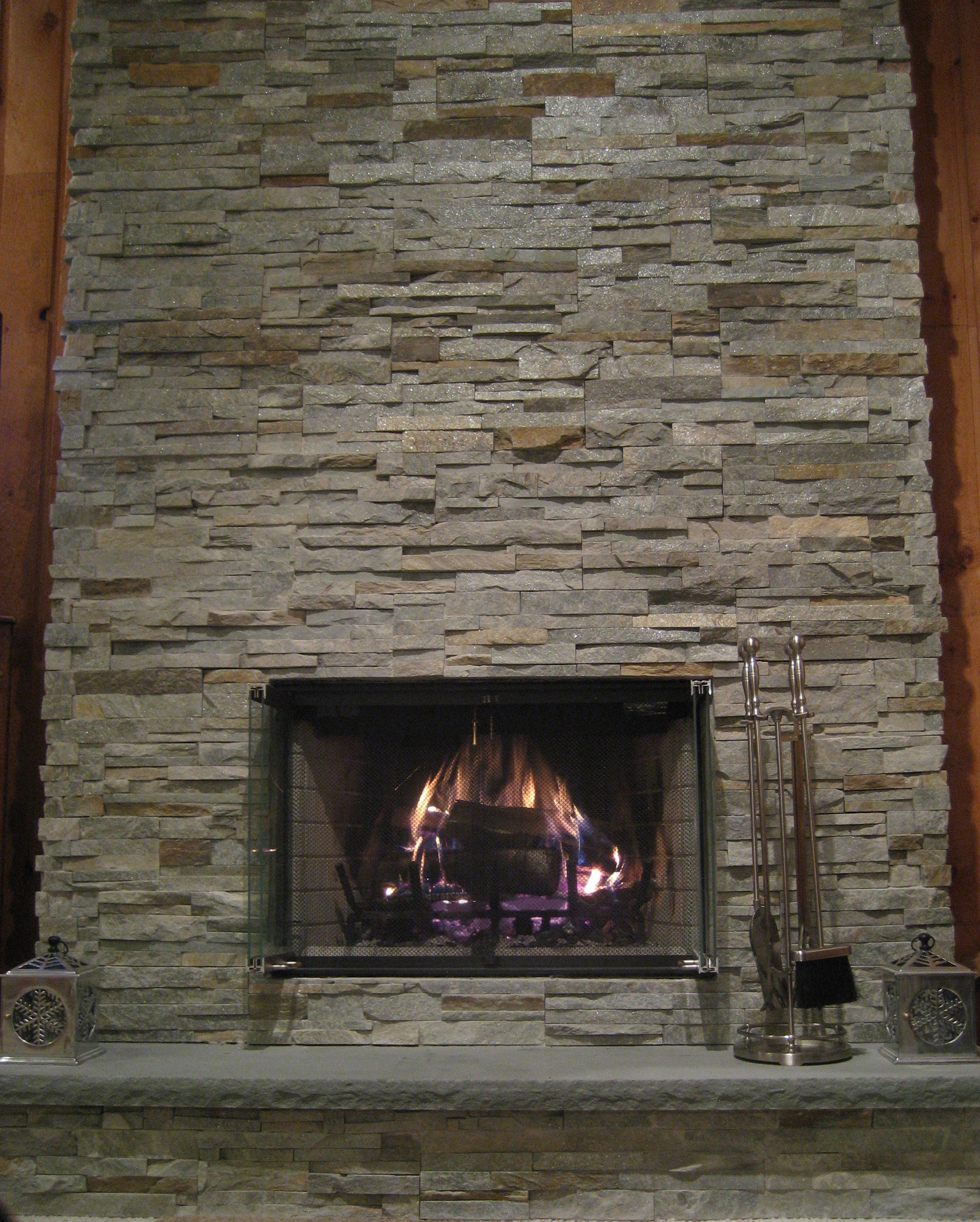 Ledge stone veneer fireplace